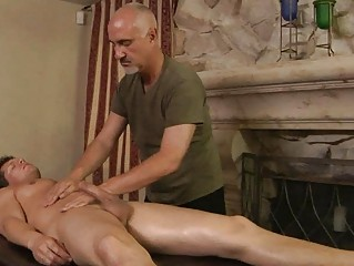 muscled tattooed gay takes oiled and massaged by