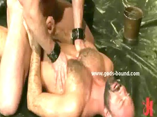 gay slave and master dressed in leather piercing