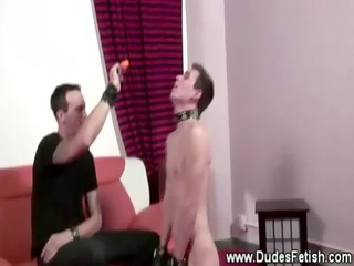 kinky gay master puts a collar on porn slave