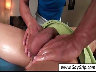 muscled masseur gives an oily massage and a