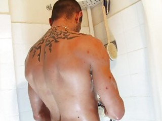 handsome gay guy dildoing under the shower
