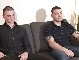 two hot looking gay men undress on the furniture