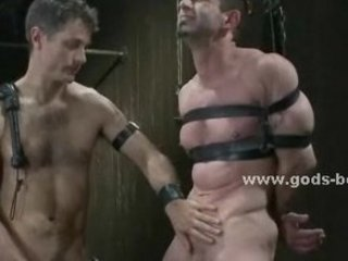 gay master tortures bound slave with wax and