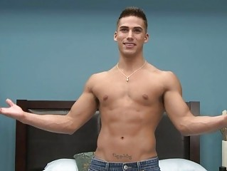 gay sex star doing a striptease into the bedroom