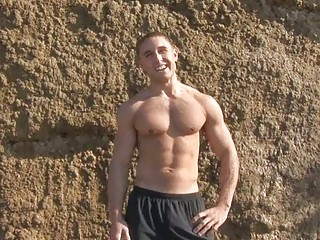 muscular gay fucker exposes on the seaside