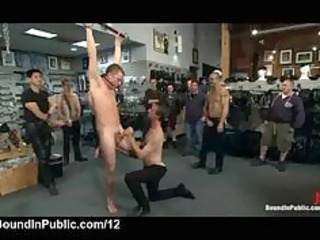 bound suspended gay humiliated in bondage shop