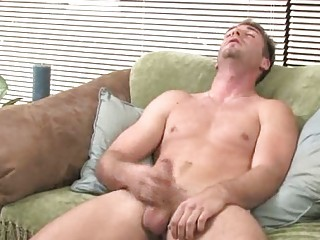 appealing brunette gay johnny rubbing his huge