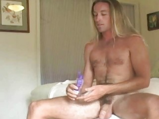 stretched haired gay stud jerks off his difficult