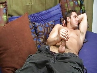 handsome gay man jerks off his plump shaft