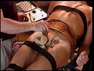 gay slave is hooked up to electric stimuli and