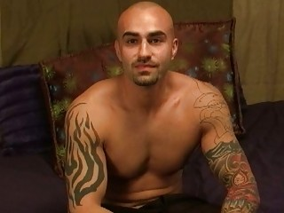 tattooed and muscular gay hunk exposes off his