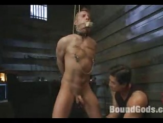 two gay masters tie up and drill two subs during