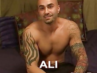 tattooed and muscular gay hunk demonstrates off